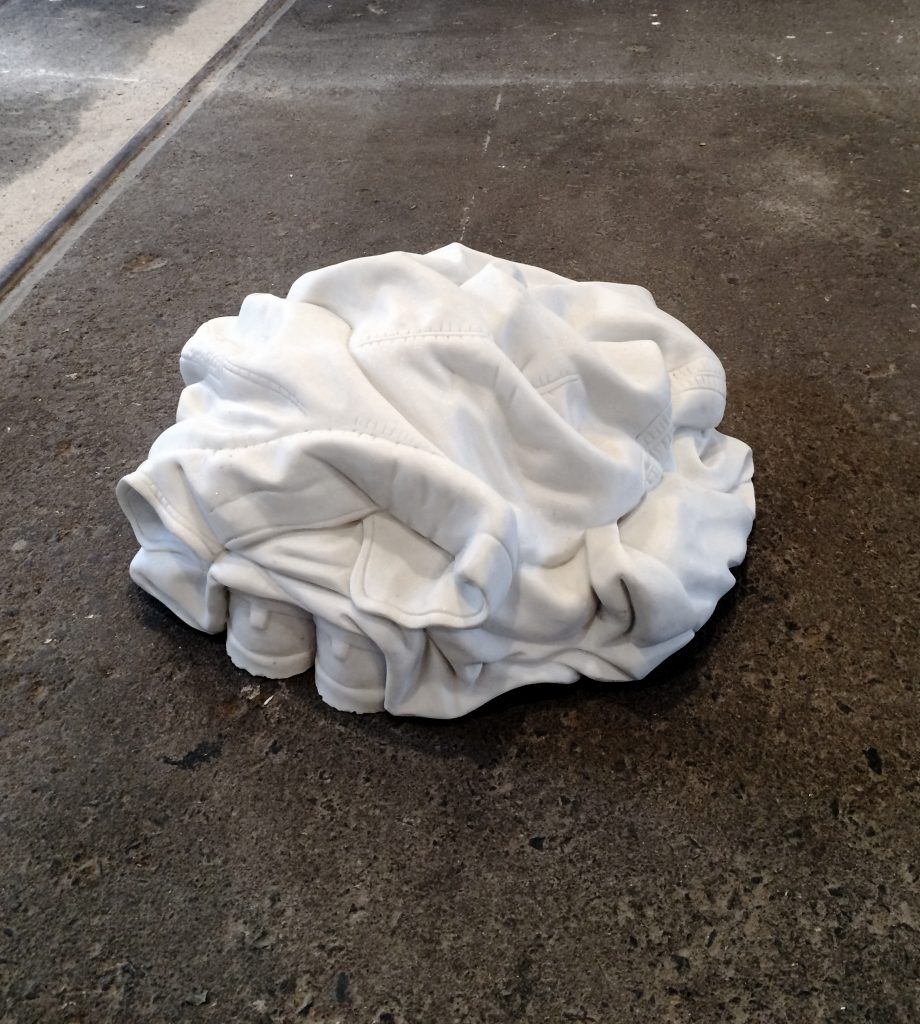 A Kassen, Pile of clothes (Marble carver), 2016.