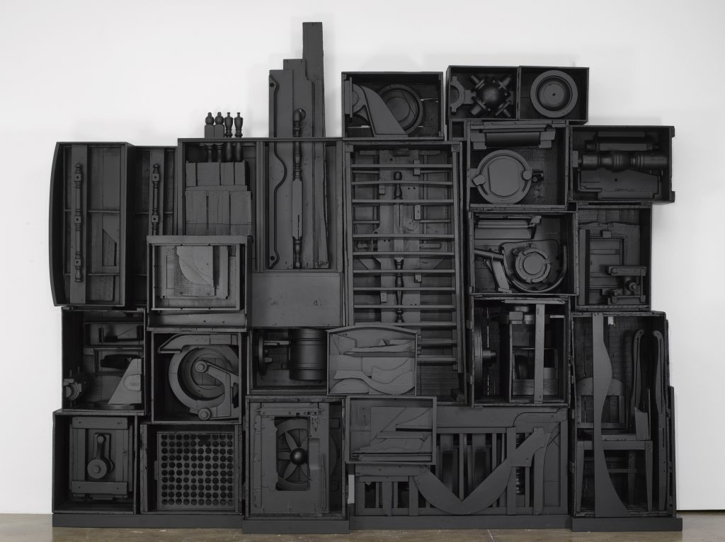 "Louise Nevelson Untitled, c. late 1970s SCULPTURE wood painted black 9' 11"" x 11' 10"" x 1' 11"" (302.3 cm x 360.7 cm x 58.4 cm), 14 elements plus 2 part base, 16 elements total © 2016 Estate of Louise Nevelson/Artists Rights Society (ARS), New York"