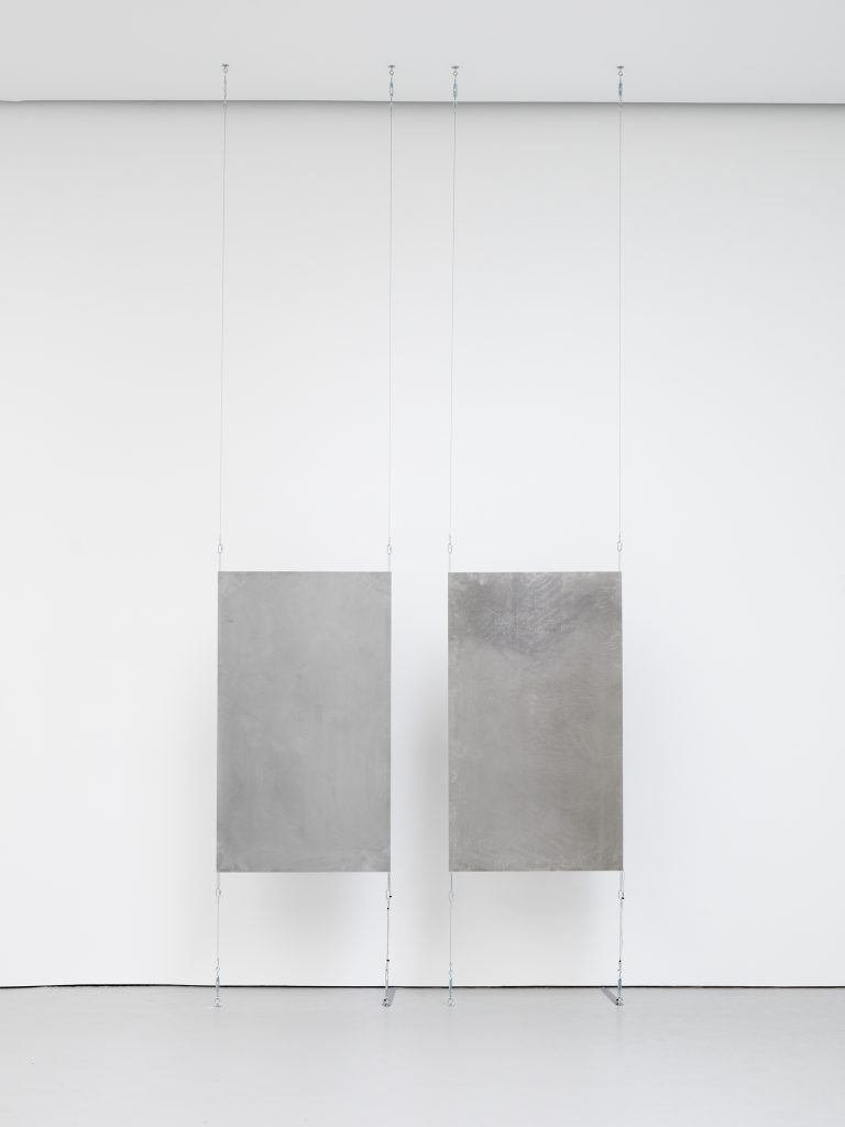 Kyle Combs Cycles, 2016 Two steel panels, surface transducers, and hardware; 16 minutes of sound, with 2 minutes of silence Dimensions variable Courtesy the artist and David Zwirner, New York/London.