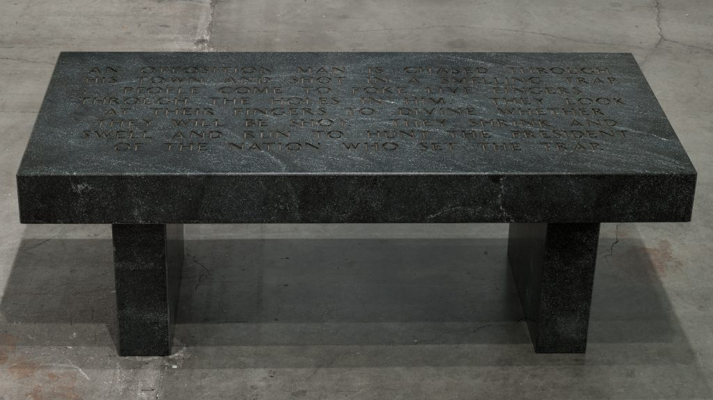 Jenny Holzer Under a Rock: An opposition man is chased through..., 1986 Gem mist black granite bench Text: Under a Rock (1986) 43,8 x 121,9 x 53,3 cm 17 x 48 x 21 inches © 2016 Jenny Holzer, member Artists Rights Society (ARS), NY Courtesy Sprüth Magers.