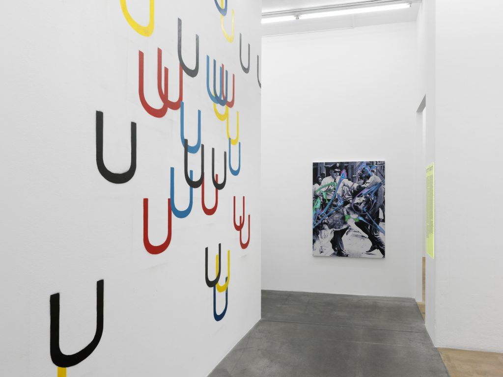On the left: Wade Guyton, U Stencil, 2006, private collection, Geneva; on the right: Kelley Walker, Aquafresh Plus Crest with Tartar Protection, 2002, Syz collection, Switzerland. Photo: Annik Wetter – MAMCO, Geneva.