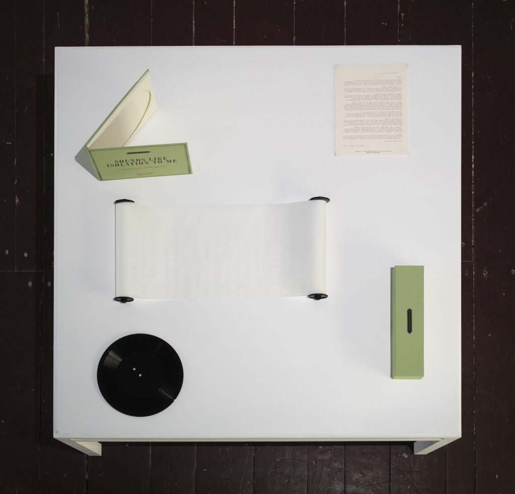 Mario García Torres, Sounds Like Isolation to Me, Acetate, cardboard, ink, linen, magnetic tape, oil, paper, sheet metal, sound, video, wire, wood, Dimensions variable.