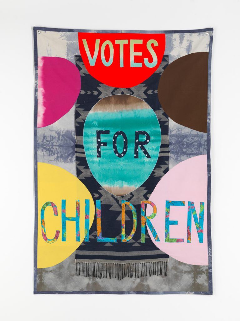 John Isaacs, Votes for Children, 2016, fabric, 200 x 137 cm, unique. Courtesy the artist and Aeroplastics contemporary, Brussels