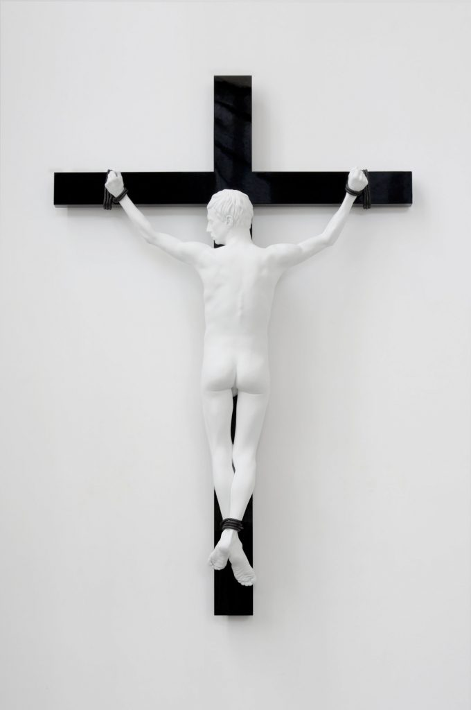 Elmgreen & Dragset 'Reversed Crucifix' 2016. Aluminum, white matt lacquer, patinated bronze figure on stainless steel, MDF, and high-gloss lacquer cross. 254 x 168 x 40 cm. Unique. Courtesy König Galerie.