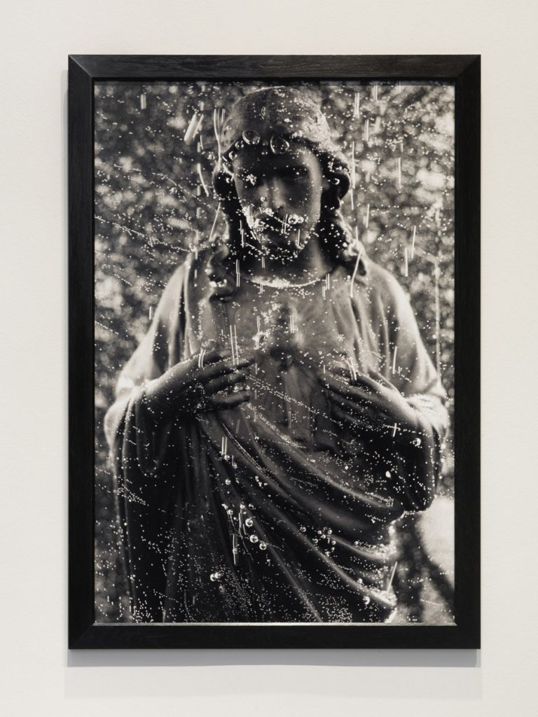 Andres Serrano 'Black Jesus (Immersions)' 1990. Cibachrome, silicone, Plexiglas, wooden frame. 152.4 x 101.6 cm. AP 2/2. Courtesy König Galerie.
