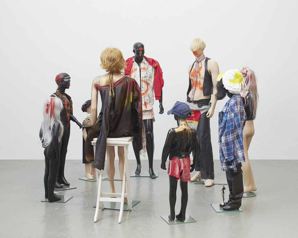Isa Genzken, 'Schauspieler (Actors)', 2016 Installation: 9 mannequins, mixed media (fabric, leather, wigs, lacquer, tape, wooden stool, glass). Dimensions installed variable. Courtesy the artist, Hauser & Wirth and Galerie Buchholz Cologne / Berlin / New York © Artists Rights Society (ARS) New York / VG Bild-Kunst, Bonn. Photo: Nick Ash