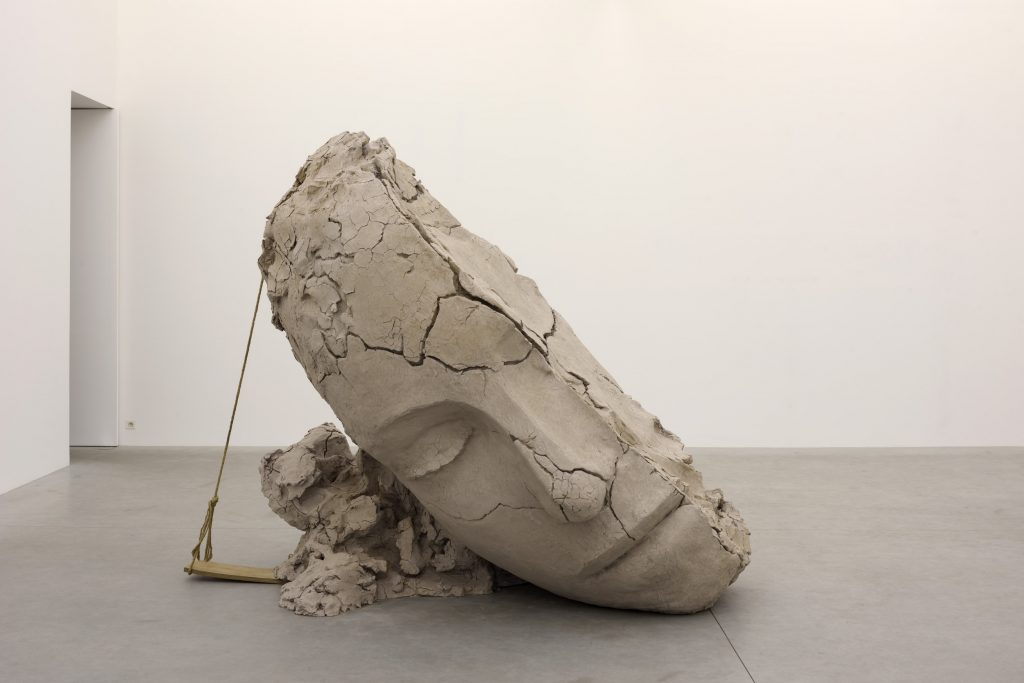 Mark Manders 'Dry Clay Head', 2015 - 2016 ca. 233 x 155 x 283 cm painted bronze, rope, plywood, offsetprint on paper. (edition of 3 + 1 AP). Courtesy the artist and Zeno X Gallery. Photo: Peter Cox.