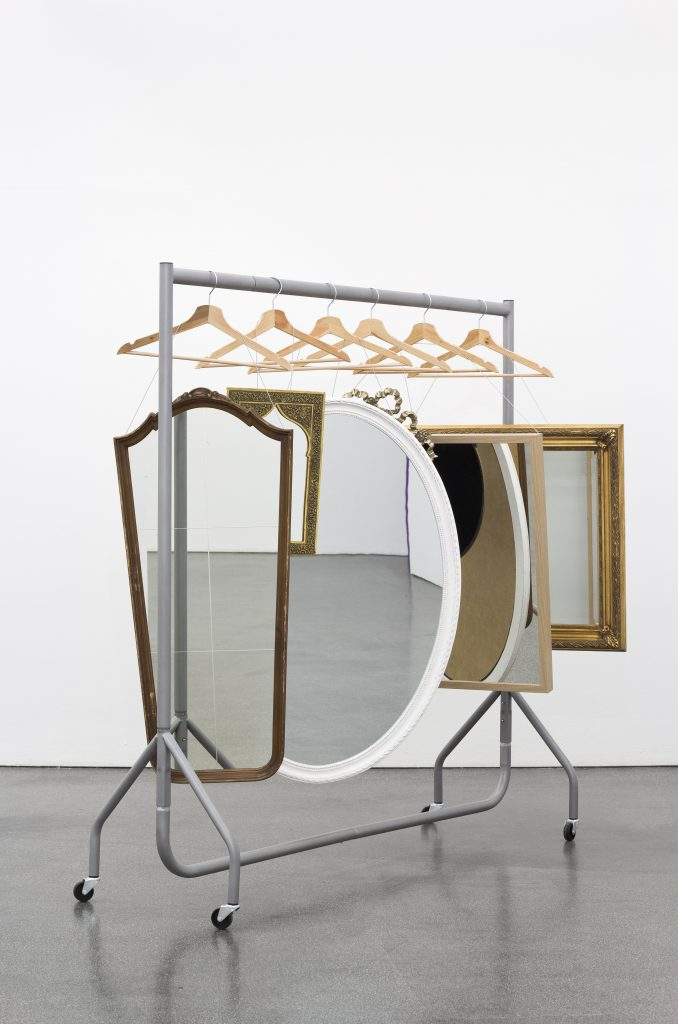 Jamie Isenstein 'Infinite Closeout Closet', 2016 six mirrors, hangers, wire, garment rack, 154 x 153 x 56 cm. Courtesy Meyer Riegger.