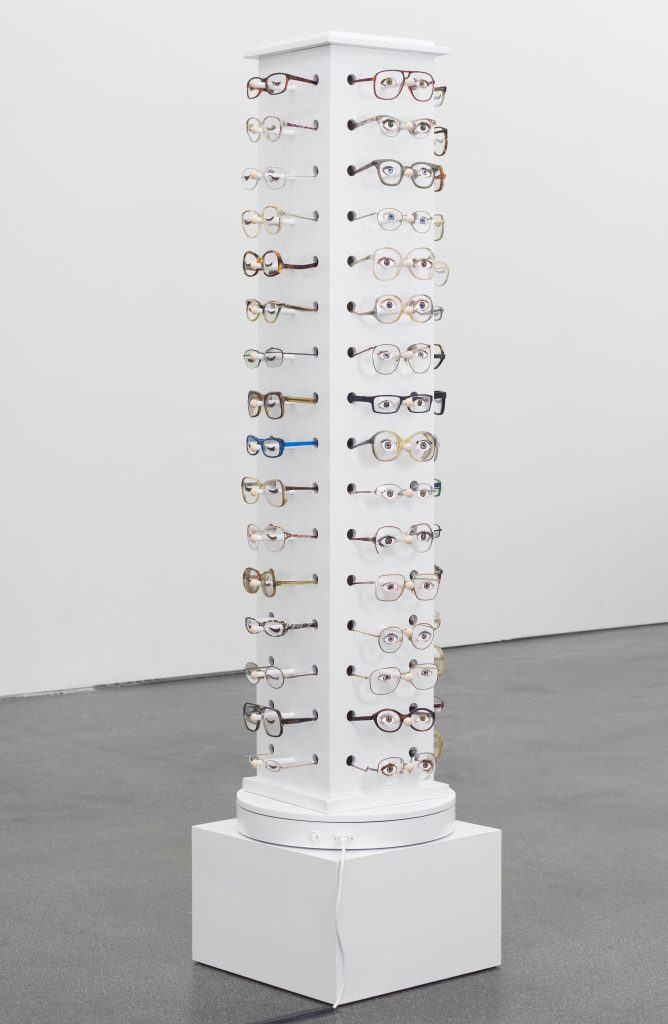 Jamie Isenstein 'Infinitely Slow Blinking Zoetrope', 2016 64 glasses, acrylic paint, wood display stand, motorized turntable, 168,5 x 40 x 40 cm. Courtesy Meyer Riegger.