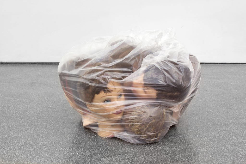 Jamie Isenstein 'Bag of heads', 2016 hairdresser mannequins with human hair, plastic bag, 40 x 63 x 44 cm. Courtesy Meyer Riegger.